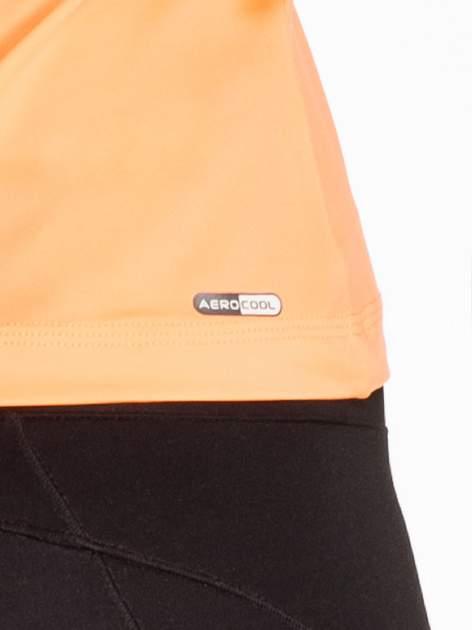 Pomarańczowy top sportowy z ozdobnym wycięciem z tyłu                                  zdj.                                  5