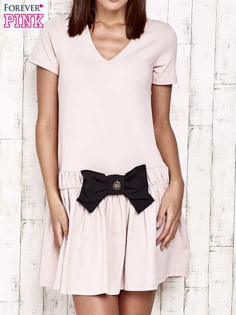 Różowa sukienka dresowa z kokardą z przodu                                  zdj.                                  1