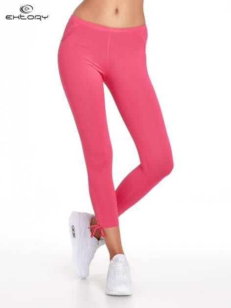 Różowe legginsy sportowe termalne z dżetami i ściągaczem                                  zdj.                                  1