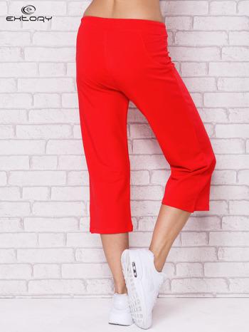 Różowe spodnie sportowe capri                                  zdj.                                  2