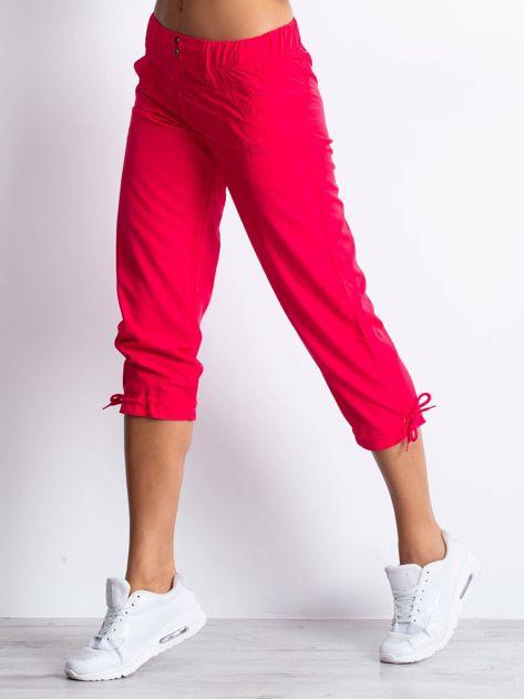 Różowe spodnie sportowe capri z guzikami                                  zdj.                                  3