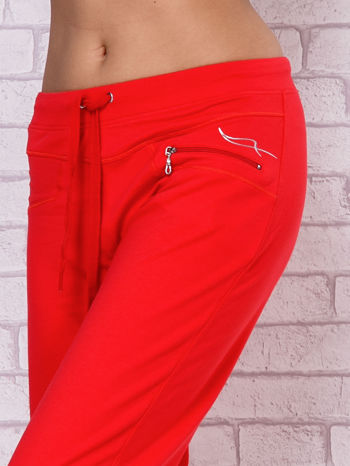 Różowe spodnie sportowe capri ze ściąganą nogawką                                  zdj.                                  4