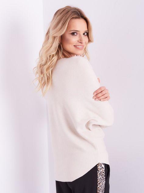 SCANDEZZA Beżowy sweter oversize z błyszczącym napisem                              zdj.                              10