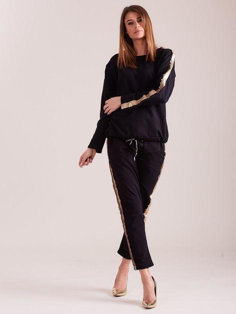 SCANDEZZA Czarna bluza ze złotymi cekinami                              zdj.                              5