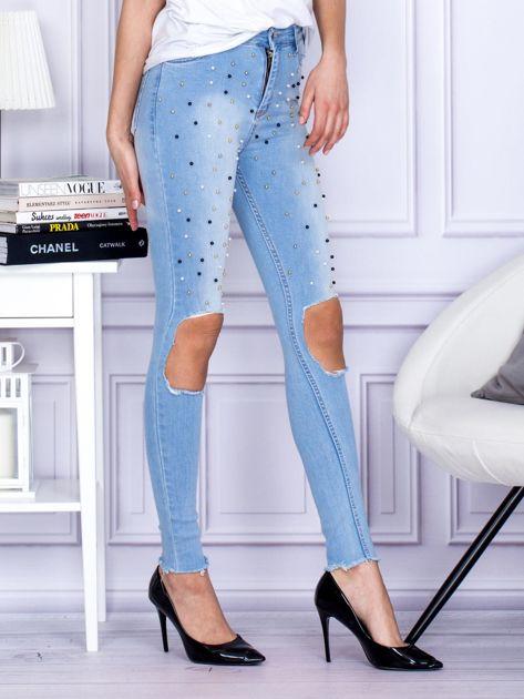 Spodnie jeansowe z dziurami i perełkami niebieskie                              zdj.                              5