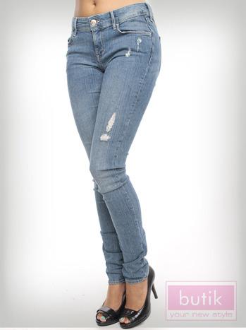 Spodnie jeasnowe z przetarciami                                  zdj.                                  3