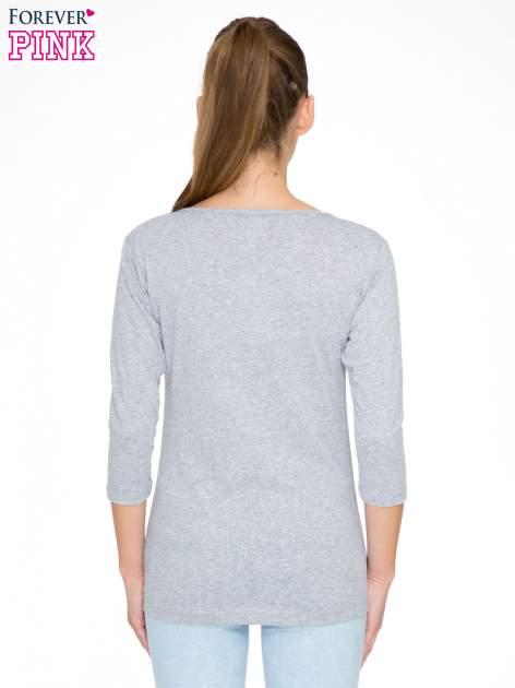 Szara bluzka z nadrukiem kobiety i napisem UNIQUE                                  zdj.                                  4