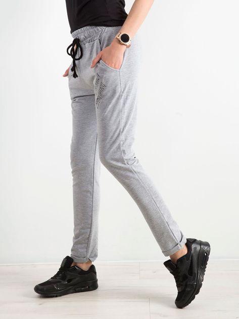 499afb592 Khaki damskie spodnie dresowe z dżetami - Spodnie Dresowe - sklep eButik.pl
