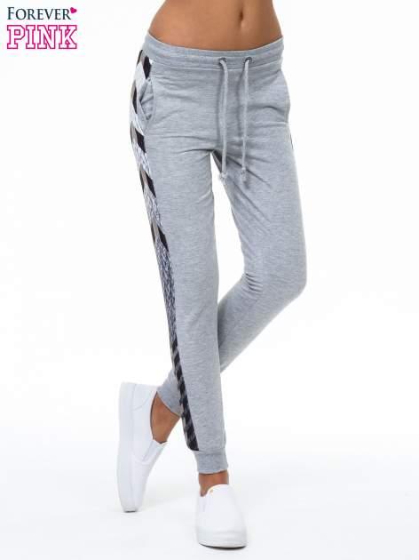 Szare spodnie dresowe z lampasem