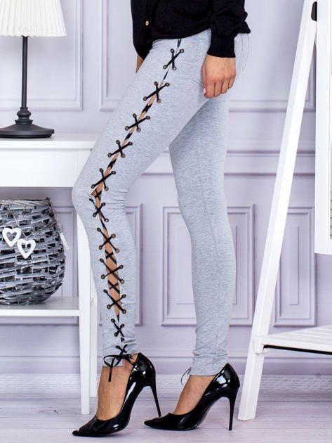 Szare sznurowane legginsy                               zdj.                              3