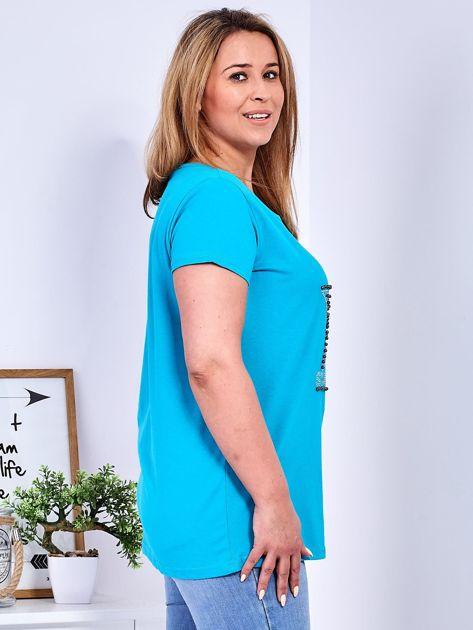 Turkusowy t-shirt z błyszczącą gwiazdą PLUS SIZE                              zdj.                              3