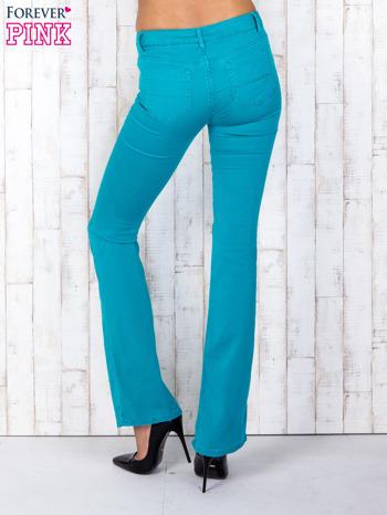 Zielone materiałowe spodnie dzwony                                  zdj.                                  2