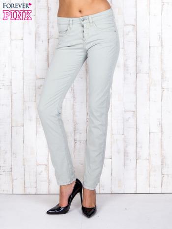 Zielone materiałowe spodnie regular na guziki                                  zdj.                                  1