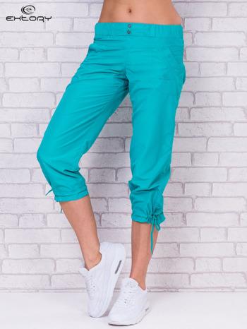 Zielone spodnie sportowe capri z guzikami                                  zdj.                                  1