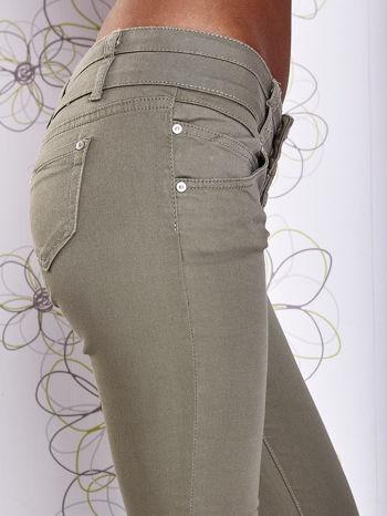 Zielone strechowe spodnie skinny z kieszeniami                                  zdj.                                  5