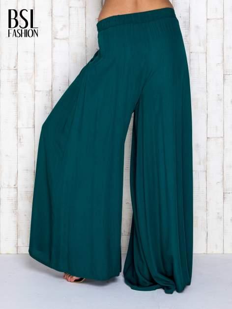 Zielone zwiewne spodnie typu culottes                                  zdj.                                  2