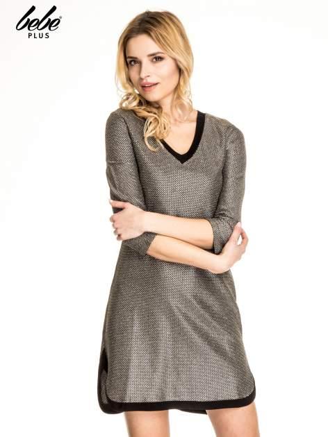 Złota sukienka z czarną lamówką                                  zdj.                                  1