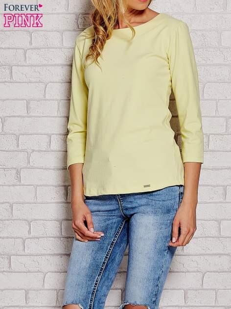 Żółta bluzka z kokardką z tyłu
