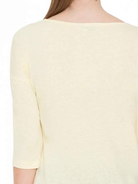 Żółta gładka bluzka z ozdobnymi przeszyciami                                  zdj.                                  7