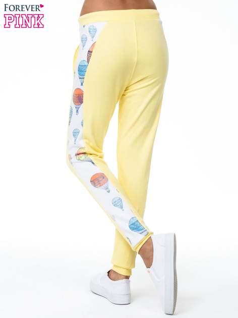 Żółte spodnie dresowe z lampasem w balony                                  zdj.                                  4