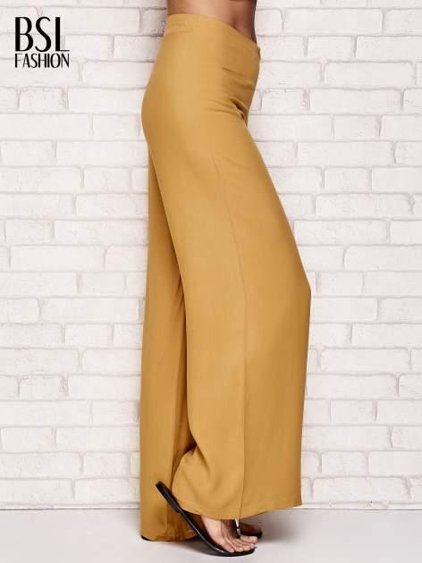 Żółte zwiewne spodnie typu palazzo                                  zdj.                                  3