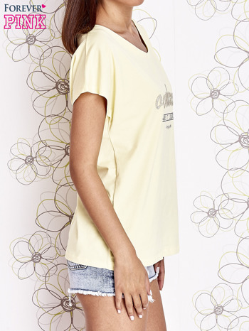 Żółty t-shirt z napisem NEED IT LOUDER                                  zdj.                                  3