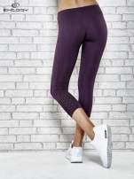 Ciemnofioletowe legginsy sportowe z dżetami na dole nogawki                                  zdj.                                  7