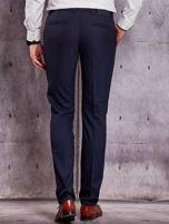 Ciemnogranatowe spodnie męskie w delikatny wzór                                  zdj.                                  2