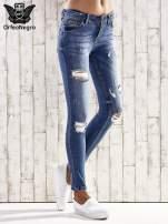 Ciemnoniebieskie spodnie skinny jeans z dziurami                                  zdj.                                  1
