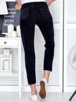 Ciemnoszare spodnie jeansowe z rozdarciami na kolanach                                  zdj.                                  2