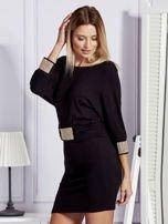 Czarna sukienka koktajlowa z biżuteryjnymi wstawkami                                  zdj.                                  5