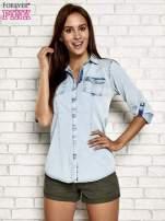 Jasnoniebieska jeansowa koszula z podwijanymi rękawami                                                                          zdj.                                                                         3