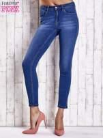Jasnoniebieskie dopasowane spodnie jeansowe                                                                           zdj.                                                                         1