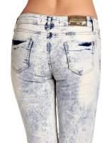 Jasnoniebieskie spodnie jeansowe dzwony z przetarciami                                  zdj.                                  7