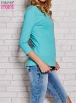 Niebieska bluzka z kokardką z tyłu                                                                          zdj.                                                                         1