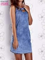 Niebieska jeansowa sukienka z wycięciami                                  zdj.                                  1