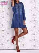 Niebieska sukienka jeansowa z plecionymi elementami                                  zdj.                                  8