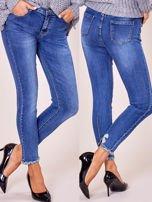 Niebieskie jeansowe spodnie z aplikacją                                  zdj.                                  5