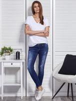 Niebieskie jeansy skinny                                   zdj.                                  4