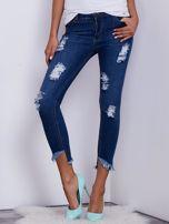 Niebieskie jeansy skinny z wystrzępieniami i przedarciami                                  zdj.                                  1