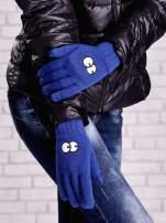 Niebieskie rękawiczki z nadrukiem oczu