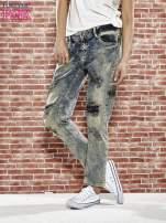 Niebieskie spodnie boyfriend jeans z szarpaniem                                                                          zdj.                                                                         1