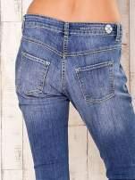 Niebieskie spodnie jeansy ze srebrnymi napami                                  zdj.                                  5
