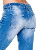 Niebieskie spodnie skinny jeans 7/8 z dziurami i przetarciami                                  zdj.                                  7