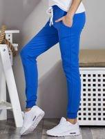 Spodnie dresowe ze ściągaczami i troczkami niebieskie                                  zdj.                                  3