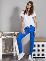 Spodnie dresowe ze ściągaczami i troczkami niebieskie                                  zdj.                                  4